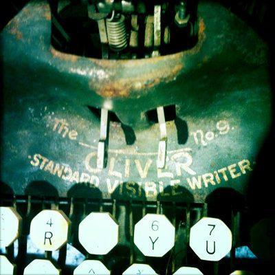 typewriter-nameplate logo